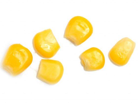 Крупные желтые зерна кукурузы символизируют достаток